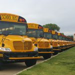 Photo of Johnston School Buses lined up outside
