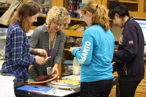 Johnston Middle School students and teacher Lisa Horsch work on a science project.
