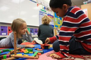 Wallace kindergartners use blocks to complete a chair for a bear