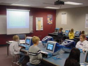 Elementary students working in the library computer lab