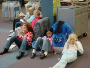 Elementary students reading in the library