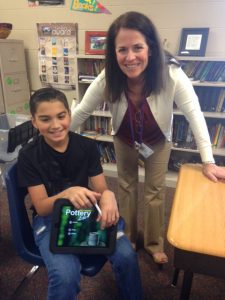 Summit teacher Nancy Ellis and a student with their new ipad