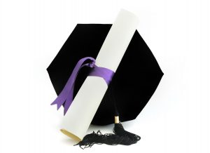 Stock photo of a diploma and cap.