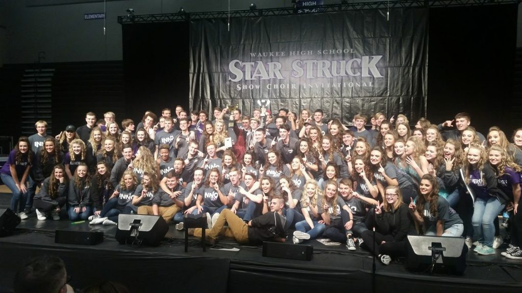 Student members of the JHS Innovation and Synergy Show Choirs pose for a photo with their grand championship trophies