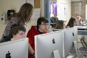 JHS teacher Kayla Bousum works with a students in one of her classes.