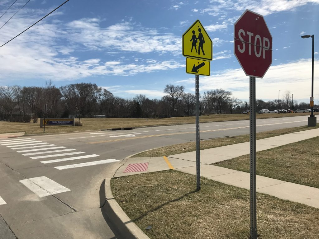new stop signs placed at lawson  timber ridge