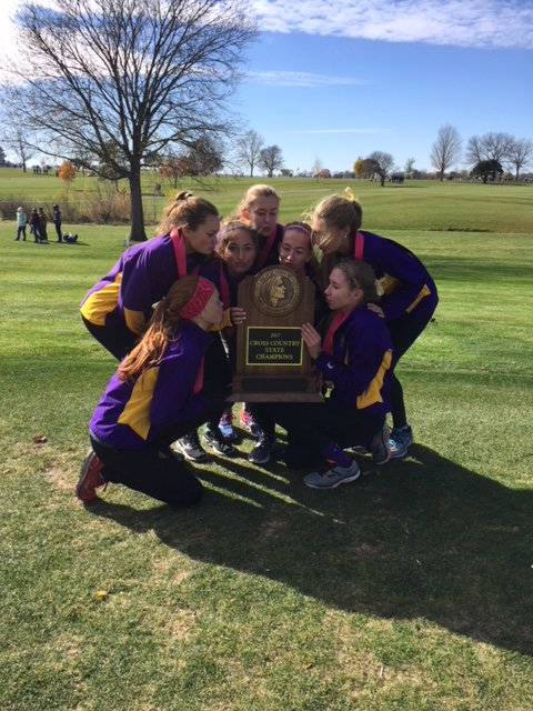 Photo of the 2017 Johnston girls cross country state champions and their trophy.