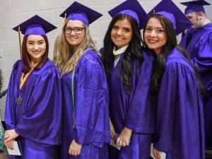 Johnston graduates Mikaela Beckley, Ciara Becker, Mirnesa Becirovic and Adnana Becirovic. Photo courtesy of Merle Laswell/The Des Moines Register.